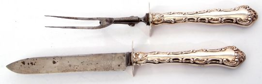 Pair of Edward VII steel bladed carvers with decorative scroll embossed silver encased handle, the