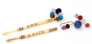 "Two mid-19th century bone/ivory lace bobbins, both with polychrome dots and ""Ann"" and ""David"", one"