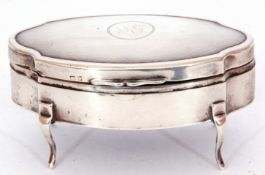 Early 20th century oval silver trinket box of hinged lobed form with a silver gilt and velvet