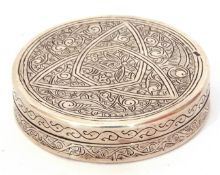 Continental white metal circular lidded box, the lid and sides chased and engraved with a