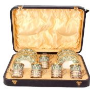 George V cased decorative Wedgwood bone china and silver coffee set comprising six saucers, five