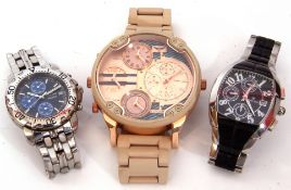 Three cased late 20th/early 21st century designer type quartz movement wrist watches including an