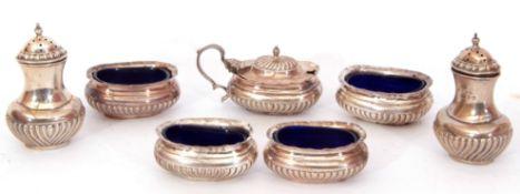 Victorian seven piece silver cruet set comprising four salts, mustard, each with blue glass