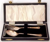Cased hallmarked silver christening spoon and fork, Birmingham 1974 and 1977, maker's mark Angora