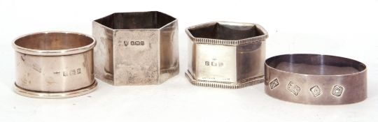 Mixed Lot: four hallmarked silver napkin rings, two hexagonal, one oval and a circular example,