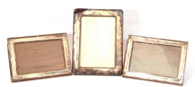 Mixed Lot: pair of George V silver photograph frames of plain rectangular form, raised edges, 16 x