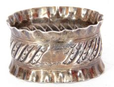 Victorian silver napkin ring of oval form, chased decorated with crimped edges, Sheffield 1893,