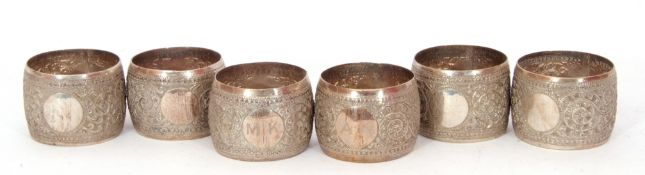Continental set of six white metal napkin rings, chased and engraved decorated with flowers and