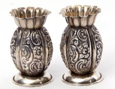 Pair of late Victorian miniature baluster vases with foliate embossed baluster body, wavy top and