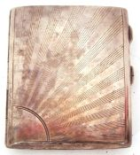 George V silver cigarette case of typical hinged rectangular form, both sides engraved with a ray of