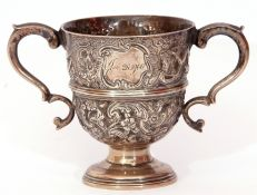 Victorian silver loving cup, profusely decorated with dogs, birds and a foliate design, having two