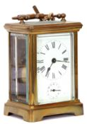 Last quarter of 19th/first quarter of 20th century brass and glass cased carriage clock of plain