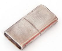 "George VI hallmarked silver ""The Howitt"" lighter of rectangular form, engine turned decoration, with"