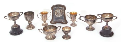 Mixed Lot: seven hallmarked silver small golf presentation trophies and socles, various dates and