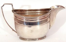 George III silver cream jug having an oval bellied body with applied beaded rim, a flat top scroll