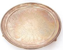 Victorian silver card salver of circular form with beaded rim, the centre engraved with a flower