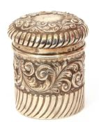 Late Victorian silver lidded canister of cylindrical form, embossed and wrythen decoration,