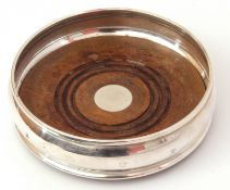 Elizabeth II silver wine coaster of plain polished circular form, treen base, 13cm diam, London