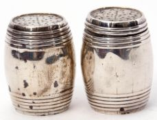 Pair of unmarked white metal pepperettes formed as coopered barrels, 5cm tall (2)