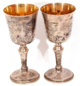 Pair of Elizabeth II silver goblets with inverted bell shaped bowls, gilt interiors on knopped stems