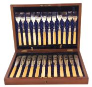 Cased set of twelve Victorian silver plated fish knives and forks, the knives engraved with a