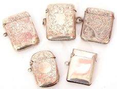 Mixed Lot: five various silver vestas, four being late 19th/early 20th century engraved examples,