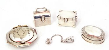 Mixed Lot: three small white metal pill boxes, one oval shaped, a sterling napkin clip, together