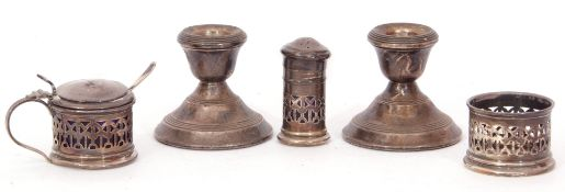 Mixed Lot: a three piece silver cruet set, a pierced drum shaped mustard and liner and matching