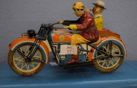 Mid-20th century tin plate model of a motor cyclist and side car both with figures