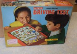Merit driving test game, boxed, with Brimtoy train set, Tri-ang Busy Baby toy and other toys (boxed)