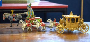 Early 20th century clockwork wind-up model of a horse and cart together with a model of the Royal