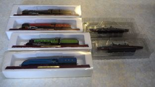 Group of boxed famous railway engines including Pacific Champion, Duchess, A4 Class Mallard,