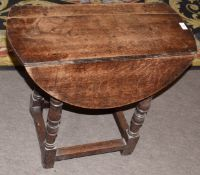 Small 19th century oak drop leaf occasional table on ring turned legs to a stretcher base, the top