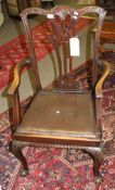 Set of seven mahogany Chippendale style dining chairs all with pierced vase shaped splat backs,