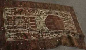 Late 19th/early 20th century Persian wool prayer rug, the centre with large panel depicting mosque
