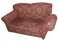 Small reproduction drop-end Chesterfield settee upholstered in red and gold floral material, width