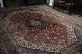 Early/mid-20th century Persian style wool carpet (worn), featuring geometric and floral patterns