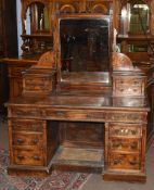 Late Victorian aesthetic period kneehole dressing table, the back superstructure with central mirror