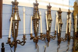 Set of five Louis XVI style carved giltwood and mirrored glass twin light wall appliques (possibly