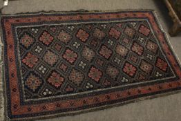 Small Caucasian rug with geometric patterns in rust and blue within five borders, 36cm x 58cm