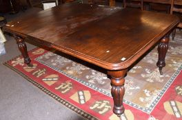Mid-Victorian mahogany extending dining table of rounded-end rectangular form and inset with one