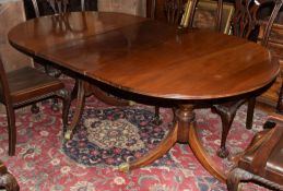 Reproduction mahogany twin pedestal dining table with one extra leaf supported on two vase turned