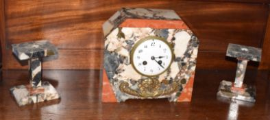 Art Deco period marble clock garniture, the clock with French striking movement, the side supports