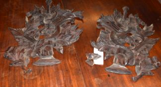 Interesting pair of carved and pierced stained softwood wall hangings in classical style featuring a