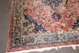 Mid/late 20th century Persian style large wool rug having geometric patterns in blue and cream to