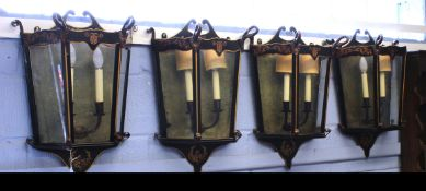 Set of four mid/late 20th century carriage style painted metal and glass wall lights with