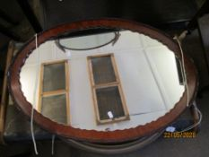 OVAL WALL MIRROR WITH SCALLOPED AND MOULDED MAHOGANY FRAME, LENGTH APPROX 80CM