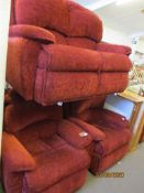 RED UPHOLSTERED THREE PIECE SUITE COMPRISING A TWO-SEATER SOFA AND TWO ARMCHAIRS
