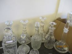 SELECTION OF EIGHT VARIOUS DECANTERS INC TWO SHIP'S DECANTERS, TALLEST INC STOPPER APPROX 32CM