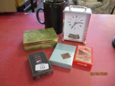 SMALL MODERN CARRIAGE CLOCK TOGETHER WITH AN ONYX CIGARETTE CASE, VARIOUS PACKETS OF CARDS ETC